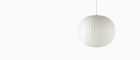 A white hanging lamp—the Nelson Ball Bubble Pendant.