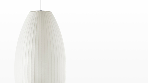 Close view of the shade on a medium white hanging lamp—the Nelson Cigar Bubble Pendant.