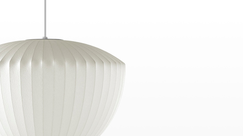 Close view of a white hanging lamp—the Nelson Apple Bubble Pendant.