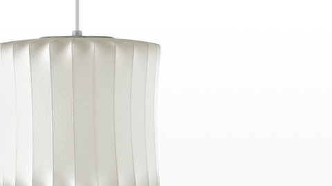 Close view of a lantern-shaped hanging lamp—the Nelson Lantern Bubble Pendant.