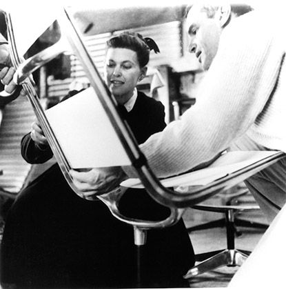 Charles and Ray Eames working on prototype chair