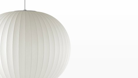 Close view of a white hanging lamp—the Nelson Ball Bubble Pendant.